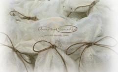 Sacchetti elegantissimi in pizzo bianco.